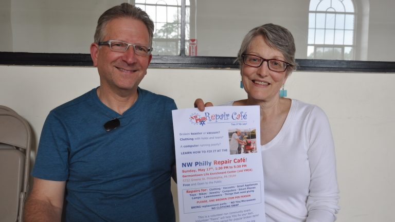 Mark Klempener (left) is a coordinator of Time4Time Community Exchange and Betsy Wallace (right) is the co-founder of the group. Both have been canvassing Northwest Philly to recruit volunteers and encourage neighbors to attend. (Greta Iverson/for NewsWorks)