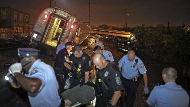 First responders help victims of the Philadelphia train derailment Tuesday night. (AP Photo/ Joseph Kaczmarek)