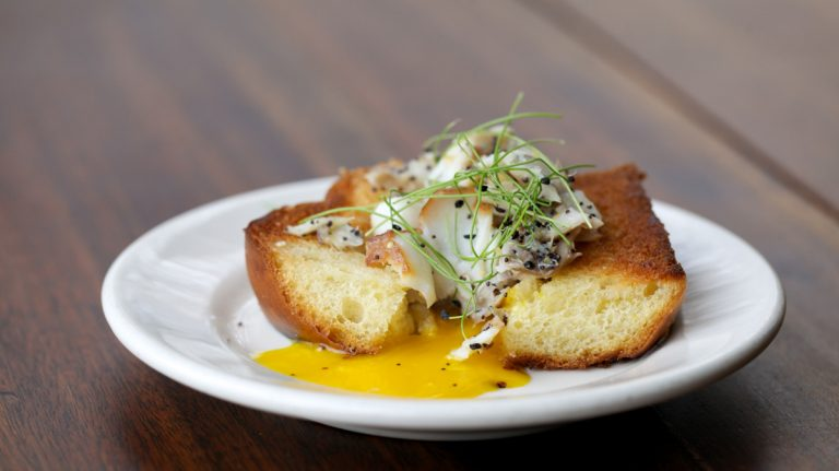 Zahav's Smoked Sable Bread, a house made challah served with egg, house smoked sablefish and topped with baby chives. (Nathaniel Hamilton/for NewsWorks)