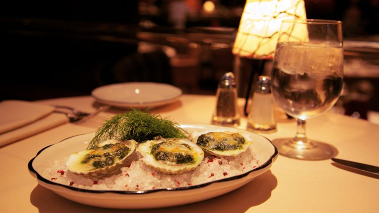 Butcher & Singer's Oysters Rockefeller: Oysters baked with spinach pernod, scallions and watercress, and topped with aged provolone and parmesan cheese. (Nathaniel Hamilton/for NewsWorks)