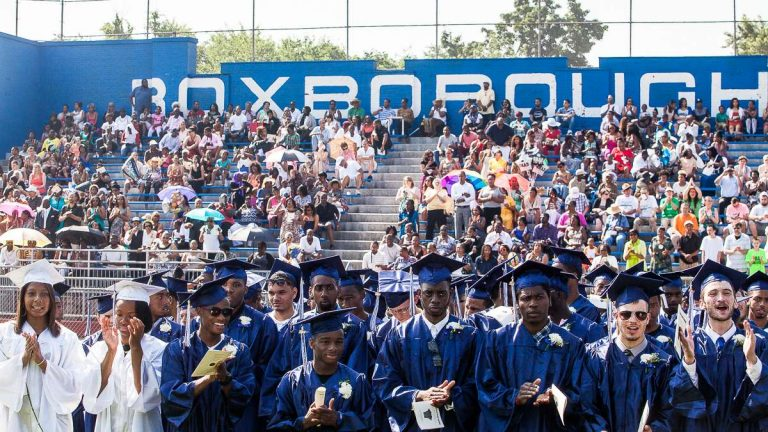 Grads and packed bleachers at the Roxborough High School 2014 Commencement. (Brad Larrison/for NewsWorks, file)