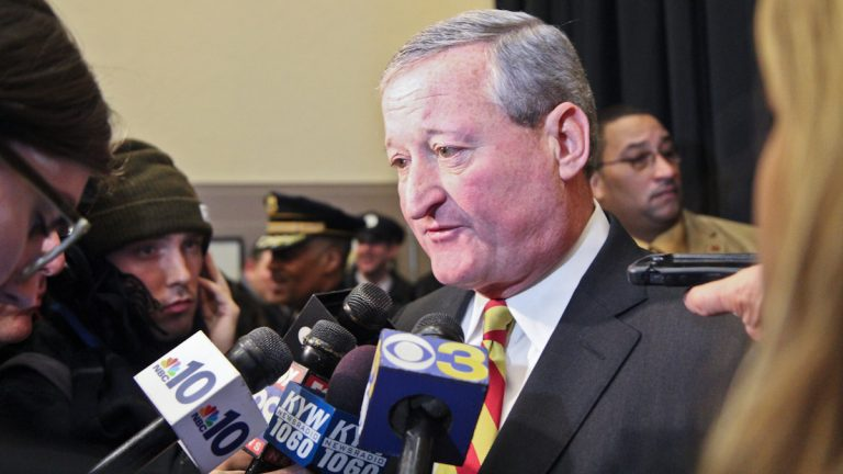 Mayor Jim Kenney talks with reporters after the swearing-in of Philadelphia's new Police Commissioner Richard Ross. (Kimberly Paynter/WHYY)