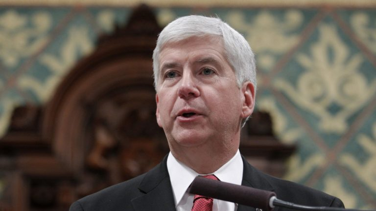 In Michigan Gov. Rick Snyder's 2016 State of the State address at the state Capitol in Lansing, he focused on Flint. (AP Photo/Al Goldis)