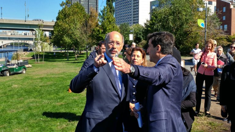 Gov. Tom Wolf and Philadelphia Managing Director Michael DiBerardinis meet on the banks of the Schuylkill River to announce a $3 million state grant to extend the Schuylkill River Trail. (Tom MacDonald/WHYY)