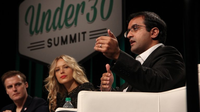 Dr. Raj Panjabi, co-founder of Last Mile Health, shares the stage with humanitarian Hugh Evans and supermodel Petra Nemcova during a panel discussion on saving the world at the Forbes Under 30 Summit. (Emma Lee/WHYY)