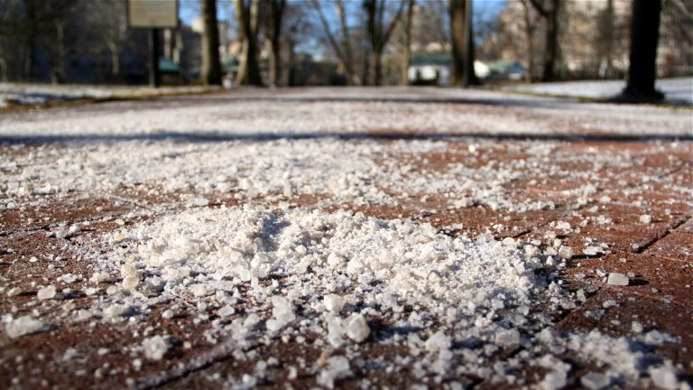Rock salt covers the walkways in Franklin Square. (Emma Lee/WHYY)