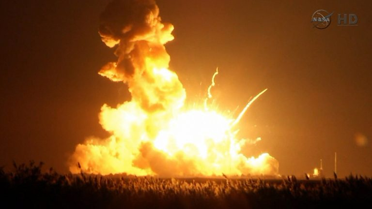 This image taken from video provided by NASA TV shows Orbital Sciences Corp.'s unmanned rocket blowing up over the launch complex at Wallops Island