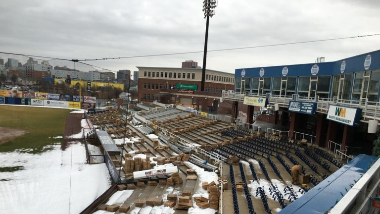 New seats ready to be installed are seen in boxes along rows at Frawley Stadium in Wilmington. (Mark Eichmann/WHYY)