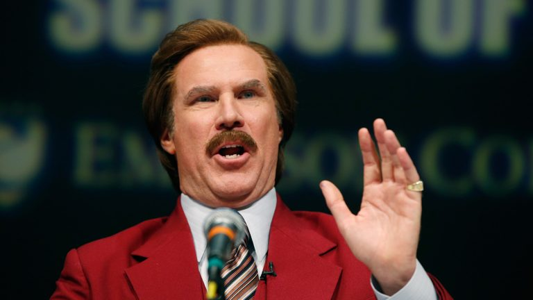 Actor and comedian Will Ferrell, speaking as TV anchorman Ron Burgundy during a news conference at Emerson College, Dec. 4, 2013. Ferrell says he modeled Burgundy after former Channel 3 anchor Mort Crim. (Elise Amendola/AP Photo)
