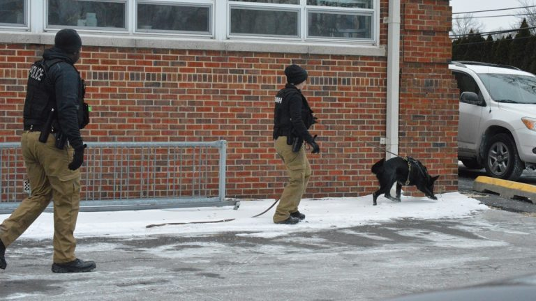Police search for clues following the shooting at Rosehill Community Center Monday afternoon. (John Jankowski/for NewsWorks)