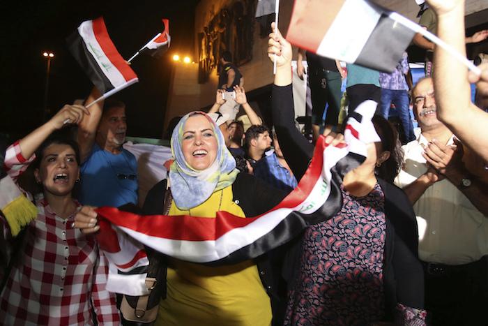 Iraqis celebrate in Tahrir square
