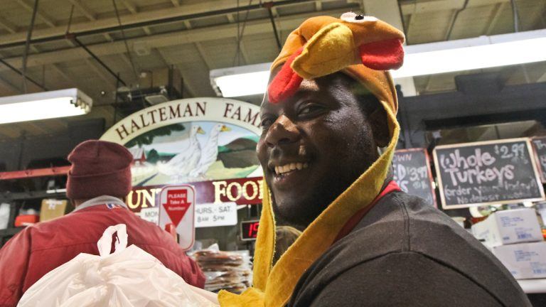 A worker in the Thanksgiving spirit at Reading Terminal Market Wednesday. (Kimberly Paynter/WHYY)