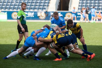 A scrum between University of Michigan and UCLA during this weekends Collegiate Rugby National Championship at Talen Energry Stadium. (Brad Larrison for NewsWorks)