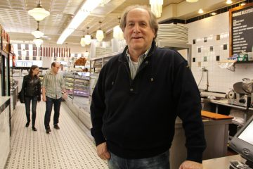 Russ Cowan owns Famous 4th Street Deli, a popular hangout for politicians on Election Day. (Emma Lee/WHYY)