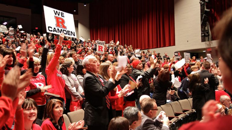 A packed house in Gordon theater responds to encouraging words from members of the Rutgers University Board of Governors during a meeting on the Rutgers-Camden campus in 2012. (Emma Lee/NewsWorks Photo, file)