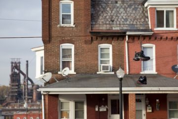 A pair of Jordan's hang from a wire on Bethlehem's southside.  The struggling neighborhood has long lived in the shadow of Bethlehem Steel and Lehigh University. (Lindsay Lazarski/WHYY)