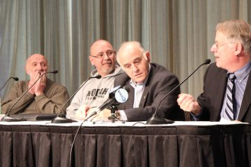From left: Raymond Lorion, dean of the education school at Towson University; Frank Borelli, a retired police detective and editor of Officer.com; Dr. Anthony Semone, a forensic psychologist who has counseled both police and the families of at-risk children; Chris Satullo, WHYY vice president of news and civic dialogue. (Kimberly Paynter/WHYY)