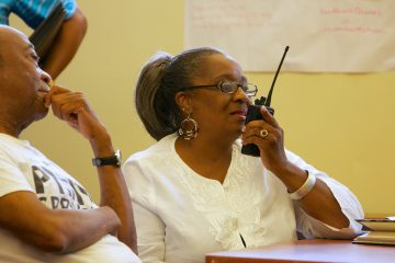 Sharon Poindexter, from Northwest Philadelphia, practiced her communication via walkie-talkie and learned some of the code words. (Nathaniel Hamilton/for NewsWorks)