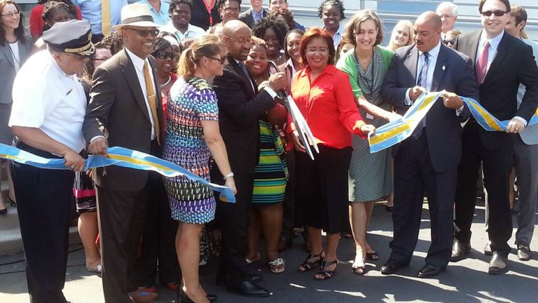 Philadelphia Mayor Michael Nutter cuts the ceremonial ribbon at the Philadelphia Safety Collaborative in Hunting Park. (Tom MacDonald/WHYY)