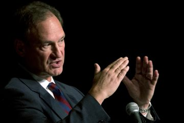 U.S. Supreme Court Justice Samuel Alito, who wrote the majority opinion in the Hobby Lobby decision, is shown speaking in in Florida in February. During the speech, Alito said that the nine justices would undermine the court's standing if they were concerned about public opinion. (AP Photo/Wilfredo Lee, file)