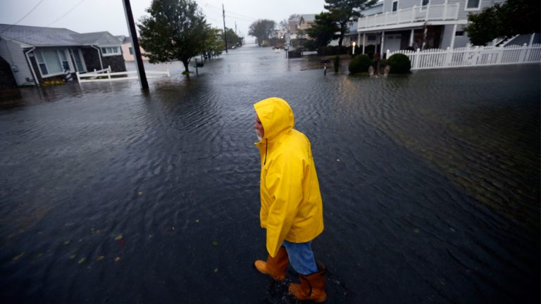 Al Daisey walks in the flood water in front of his home as Hurricane Sandy bears down on the East Coast, Monday, Oct. 29, 2012, in Fenwick Island, Del. (Alex Brandon/AP Photo, file)