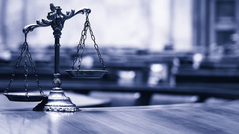 "<a href=""https://www.bigstockphoto.com/image-144986045/stock-photo-symbol-of-law-and-justice-in-the-empty-courtroom-law-and-justice-concept-blue-toned"">(Symbol of law and justice/BigStock)</a>"