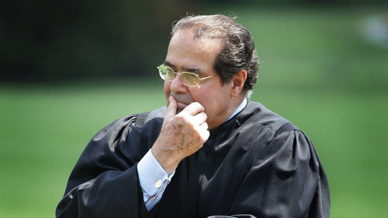 Supreme Court Justice Antonin Scalia is shown in this 2006 file photo listening to President Bush speak on the South Lawn at the White House in Washington. Scalia has died at the age of 79. (AP Photo/Ron Edmonds, File)