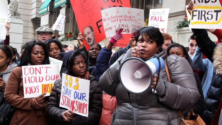 Students, parents and education advocates attend a rally outside Gov. Tom Wolf's Philadelphia offices to pressure the administration to lift restrictions on the Educational Improvement Tax Credit that provides scholarships to low-income students. (Emma Lee/WHYY)
