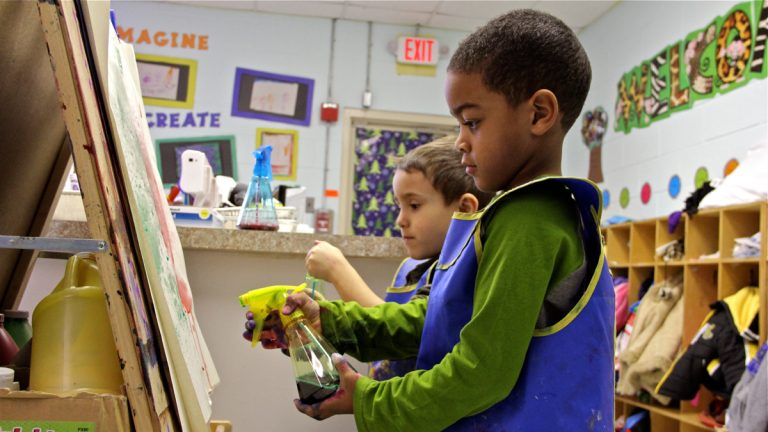 Preschoolers paint together using spray bottles at Paley Early Learning Center in Northeast Philadelphia. (Emma Lee/WHYY