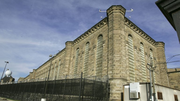 Fences and razor wire are seen around the yards behind the former State Correctional Institution in Pittsburgh. (AP File Photo/Keith Srakocic)