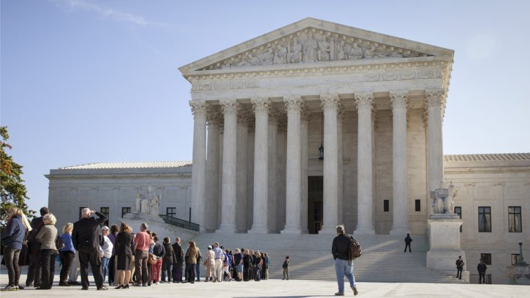 People are shown waiting to enter the Supreme Court in Washington as it begins its new term on Oct. 6, 2014. (AP Photo/J. Scott Applewhite, file)