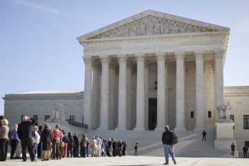 People wait to enter the Supreme Court in Washington