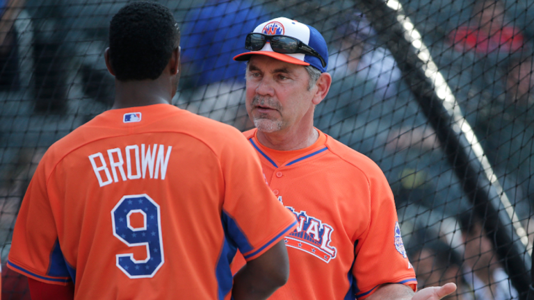National League manager Bruce Bochy of the San Francisco Giants talks with Domonic Brown during batting practice for the MLB All-Star baseball game. (AP Photo/Matt Slocum)