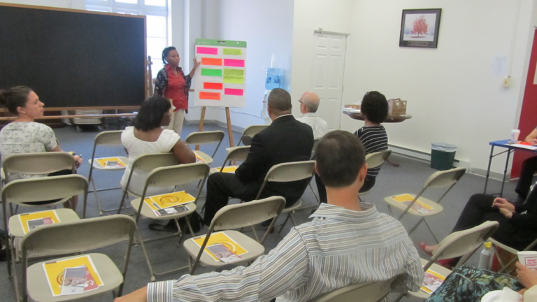 Representatives of community groups in Germantown and other Northwest Philadelphia neighborhoods gathered at state Rep. Stephen Kinsey's office for a confab on Thursday. (Aaron Moselle/WHYY)