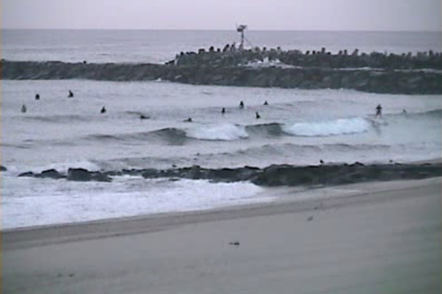 Surfers at the Manasquan Inlet. (Image: TheSurfersView.com)