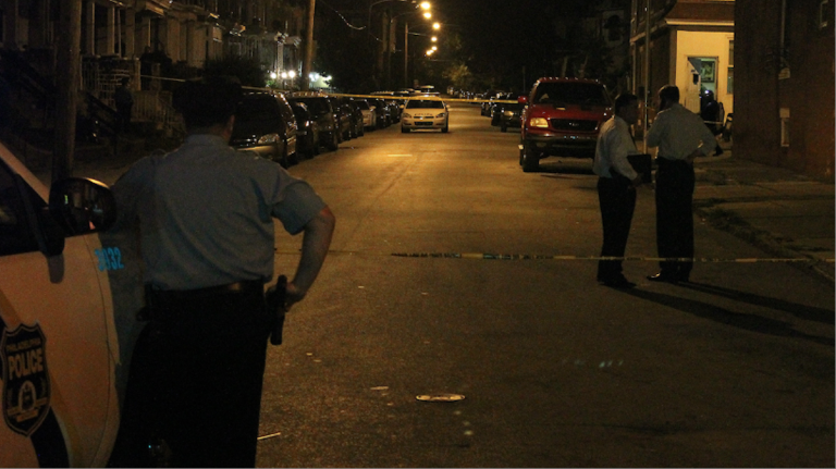 Police on the scene of Tuesday night's fatal shooting in Germantown. (Matthew Grady/for NewsWorks)