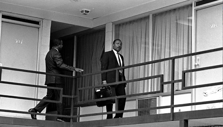 Rev. Martin Luther King, Jr. is pictured walking across the balcony of the Lorraine Motel in Memphis, Tenn. at approximately the spot where he was shot by a hidden assassin. This picture was made, April 3, 1968, the day before the shooting, shortly after King arrived in Memphis. (AP Photo/stf)