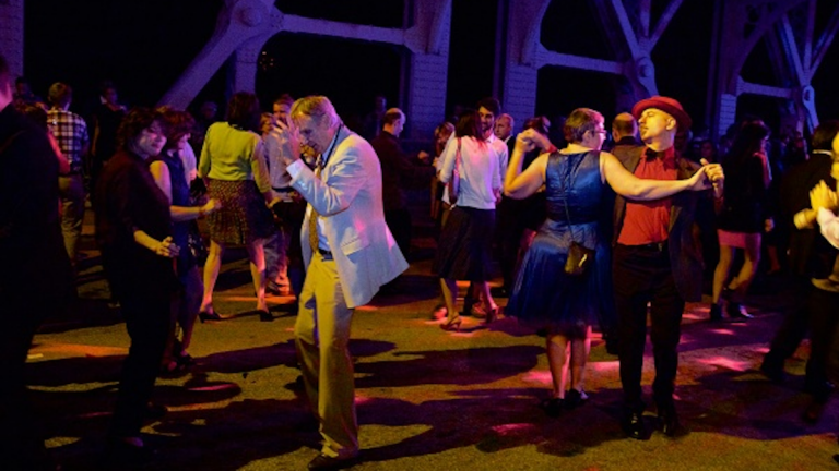 They grooved the night away in East Falls during last year's second annual Dance on the Falls Bridge. (Jana Shea/for NewsWorks)