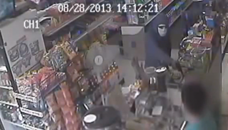 Surveillance footage of the armed robber. (Courtesy of Philadelphia Police)