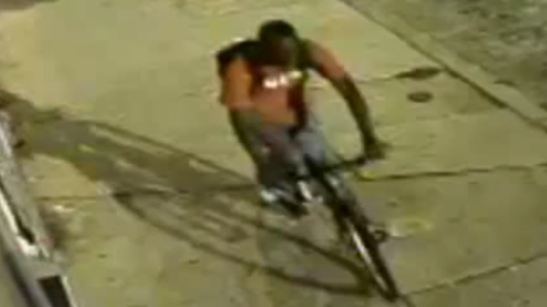 Surveillance footage of the alleged robber making off on his victim's bicycle. (Courtesy of PPD)