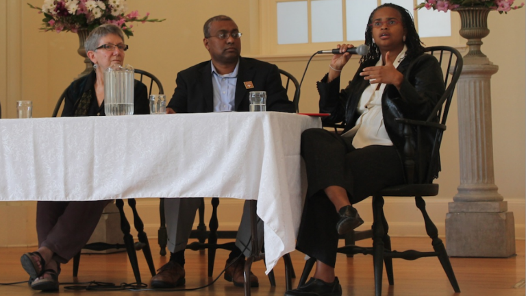 Rev. Leslie Callahan, seated with Iftekhar Hussain and Rabbi Linda Holtzman, examines gun violence through the lens of theology at Sunday's event in Chestnut Hill. (Matthew Grady/for NewsWorks)