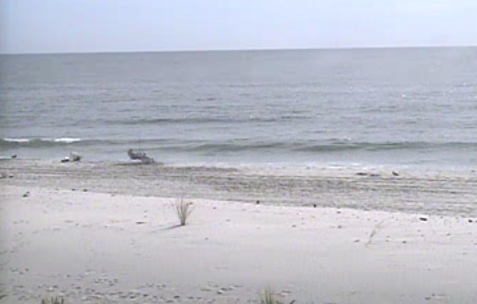 A lone fisherman in Beach Haven at about 10:20 a.m. today. (Image: TheSurfersView.com)