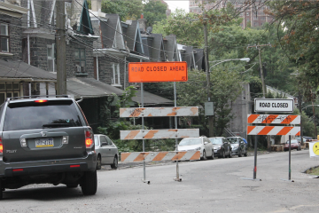 A driver considers ignoring detour signs on Rittenhouse Street in Germantown. Four other motorists in a little under 10 minutes weren't quite as reluctant. (Matthew Grady/for NewsWorks)