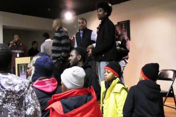 Tyree Dumas (bottom row center) with young men from his program, The Dollar Boyz. (Solomon Jones/for NewsWorks)