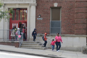 Students are led away from Thomas Mifflin Elementary School on Tuesday after a pre-K student was found with what is believed to be crack cocaine in his pockets. (Bas Slabbers/for NewsWorks)