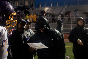 The MLK Cougars raised their season record to 5-2 with a rain-soaked victory over Boys Latin on Friday. (Brad Larrison/for NewsWorks)