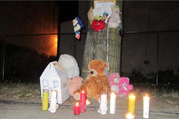 A roadside vigil for hit-and-run victim Ceeanna Pate. (Brian Hickey/WHYY)