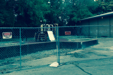 The playground at McDevitt Rec Center in East Falls was fenced off prior to the start of a $300,000 improvement project. (Brian Hickey/WHYY)