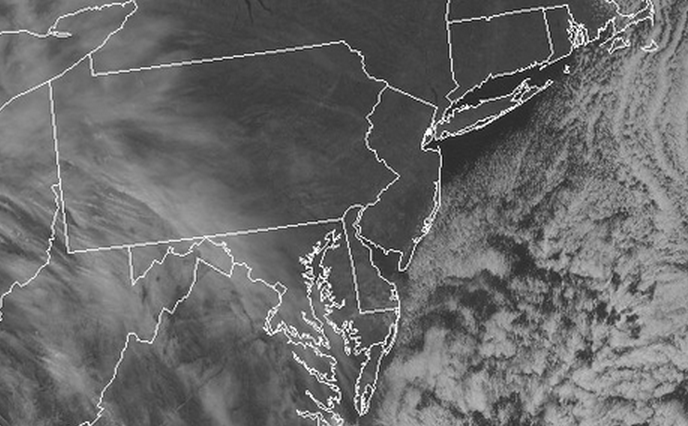 The visible satellite at 12:45 p.m. today, indicating mostly clear skies over New Jersey and immediately adjacent areas.