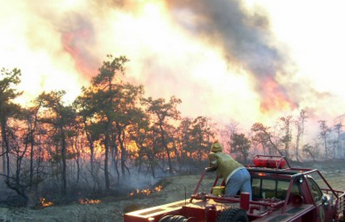 A firefighter on the scene of a fire at Warren Grove in southern Ocean County in 2004.